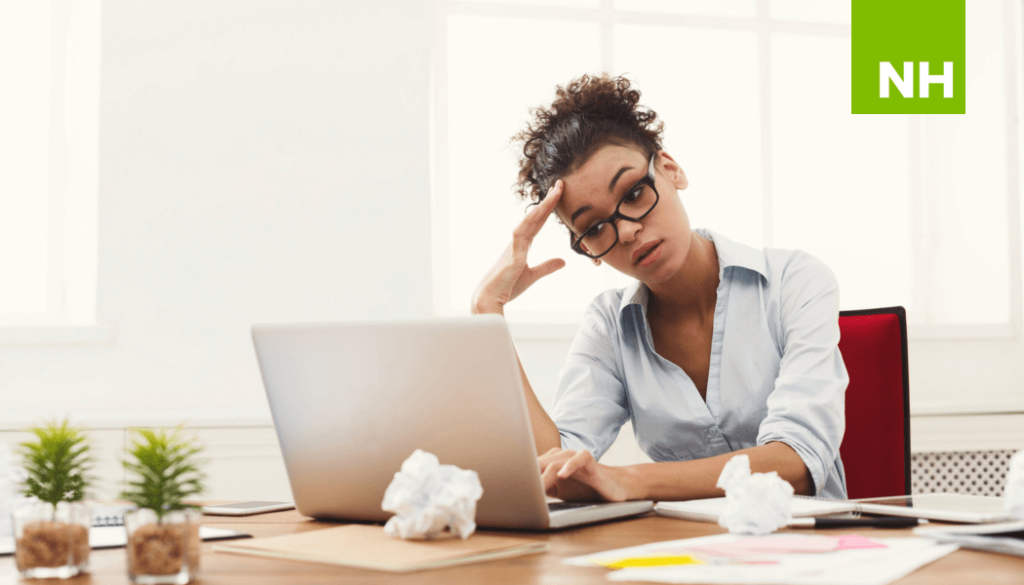 Frustrated woman sitting at desk